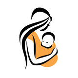Mom holding her baby. In a sling Royalty Free Stock Photos