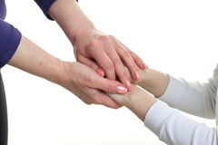 Mom holding her daughter by the hand Stock Photos