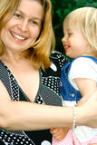 Mom holding her toddler daughter Royalty Free Stock Photo