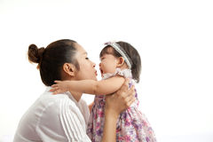Mom is holding and playing with her baby Royalty Free Stock Photography