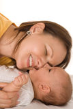 Mom and holds the baby. Happy mom and holds the baby stock images