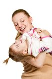 Mom holds the child in her arms and plays stock image