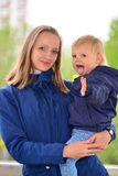 Mom holds daughter on hands in  walk Royalty Free Stock Photos