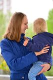 Mom holds daughter on hands in  walk Royalty Free Stock Photo