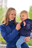 Mom holds daughter on hands in  walk Stock Images
