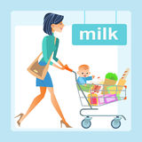 Mom hopping cart baby store. Mom with the shopping cart with a baby in the store. In the cart the products and the boy, the milk section Royalty Free Stock Photos