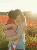 Mom Hug. With backlight in outdoors  garden Stock Photo