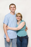 Mom hugging adult son royalty free stock photo