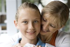 Mom hugging daughter. stock images
