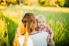 Mom hugging her son. Mother hugs her son in the park royalty free stock photography