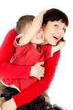 Mom hugging with a small child Stock Photo
