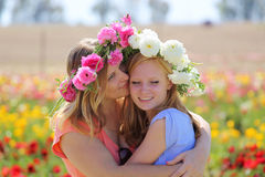Mom hugging teenage daughter. In a flowering field Royalty Free Stock Photography