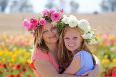 Mom hugging teenage daughter. Loving portrait of a mom and her teen daughter Royalty Free Stock Photo