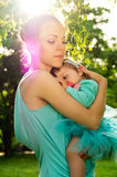 Mom hugs baby at sunset Royalty Free Stock Photography