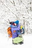 Mom hugs the child. The kid hugs Mom. A boy with his mother on a winter walk. A child kisses his mother. The women supports her son. Motherhood. The family royalty free stock image