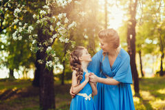 Mom hugs daughter on nature Stock Image