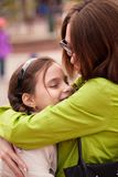 Mom hugs her daughter Stock Image