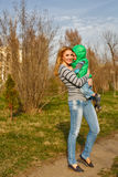 Mom hugs her son. Mom hugs her son in the autumn park. Family time. Happiness of childhood and motherhood. Outdoor Activities royalty free stock images