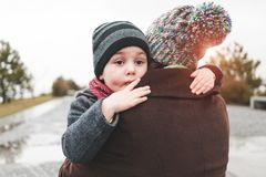 Mom hugs her son. Mom hugs her son in the street. The joy of meeting mother and child. A women is kissing a boy royalty free stock photos