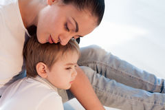 Mom hugs her son sadness love Stock Photo
