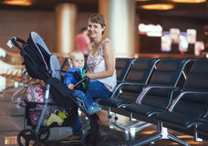 Mom and infant communicate while waiting for his flight Royalty Free Stock Images