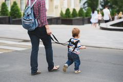 Mom insures her child during a walk Royalty Free Stock Photography