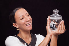 Mom keeps daughter in a glass jar and are very happy Stock Image