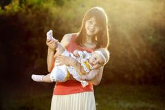 Mom keeps daughter in her arms Royalty Free Stock Photos