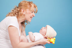Mom keeps on hand a baby son love happiness Stock Image