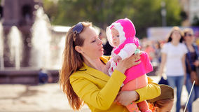 Mom keeps on hand a small child. Royalty Free Stock Photo