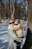 Mom keeps a little girl in his arms the winter Stock Photography