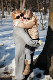 Mom keeps a little girl in his arms the winter Royalty Free Stock Images