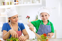 Mom and kid cooking together Stock Image