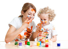 Mom and kid daughter paint Royalty Free Stock Photography
