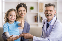 Mom with kid at the doctor. Stock Photos