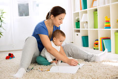 Mom and kid drawing. With wax colors Stock Photo