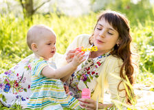 Mom and kid girl having fun outdoors Royalty Free Stock Photography
