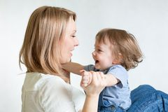 Mom and kid having fun pastime. Parenthood Stock Photos