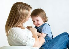 Mom and kid having fun pastime. Parenthood Stock Photography