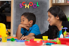 Mom and Kid in Home School Setting Royalty Free Stock Image