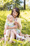 Mom and kid outdoors at summer Royalty Free Stock Photo