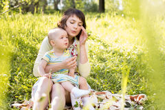 Mom and kid outdoors at summer Stock Images