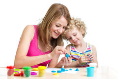 Mom and kid play colorful clay toy Stock Photography