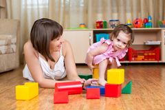 Mom and kid play toys at home Royalty Free Stock Photos