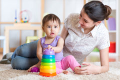 Mom and kid playing block toys at home Royalty Free Stock Photography