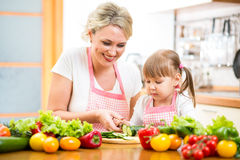 Mom and kid preparing healthy food Stock Photography