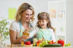 Mom and kid preparing healthy food Royalty Free Stock Photos