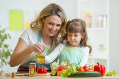 Mom and kid preparing healthy food Stock Images
