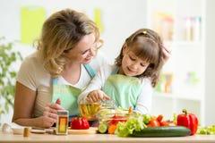 Mom and kid preparing healthy food Stock Image