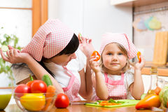 Mom and kid preparing healthy food. Mother and kid preparing healthy food royalty free stock photos